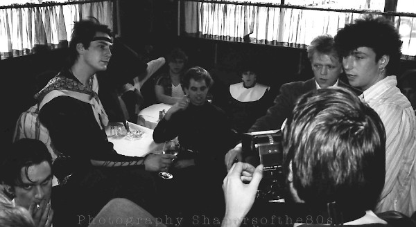 Decoding the heritage: press conference at Vandam's restaurant with Hadley, Norman, Burgess, Fouratt, Mole and assorted Blitz Kids. Below right, Graham Smith explains his photo portfolio on the Blitz  heritage to New Yorker Richard Buckley. Photographed © by Shapersofthe80s