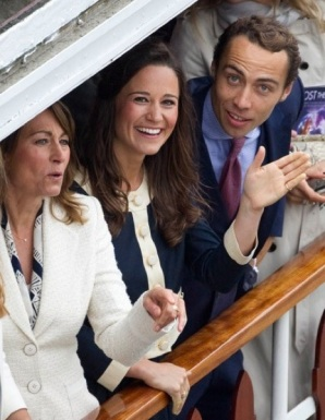 Wills' mother-in-law Carole Middleton, Pippa and James aboard the Elizabethan, a replica 1890s Mississippi paddle steamer (Photo: Rex)