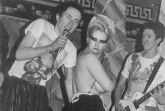 Tits out! Jordan with Sex Pistols at Andrew Logan's Valentine party, 1976