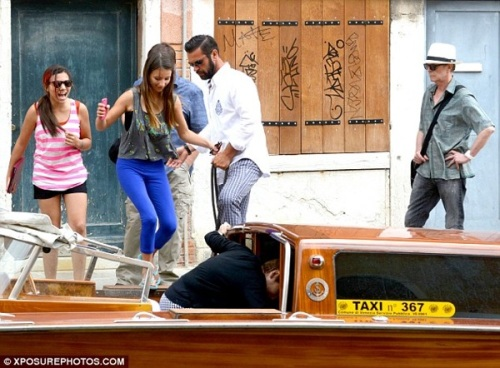 The Bowies' day out: beaming from ear-to-ear, Lexi and friend climb aboard a water taxi in Venice yesterday
