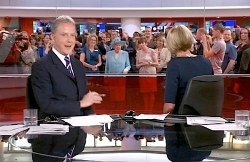 1 – Live on the BBC's rolling news channel: anchor Sophie Long has already noticed HMQ photobombing their bulletin as the Queen tours the newsroom at New Broadcasting House